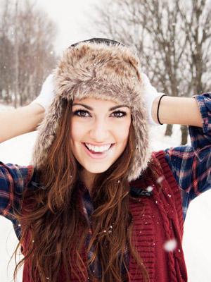 woman-wearing-winter-hat-snow